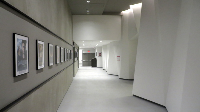 The hallways of the brand-new campus are lined with 150 framed movie posters listing the names of VFS grads who worked on the production