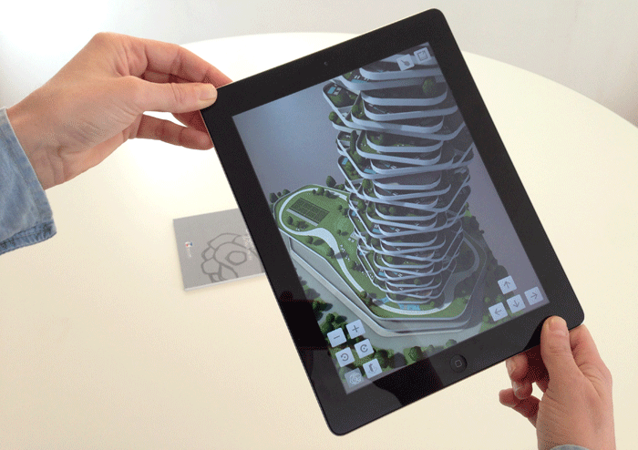 A next generation residential building that will be built in Shanghai. Using a tag on a desk, users can walk around and see the 3D building model on a tablet